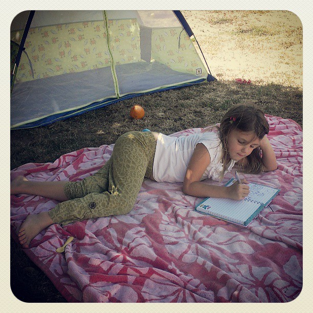 Writing all her summer dreams in her journal...