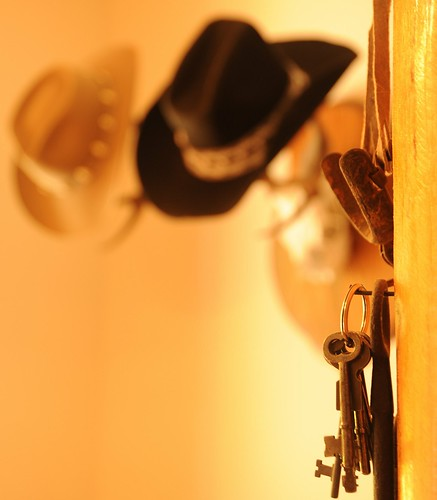 Keys and spurs, black and tan cowboy hats on the deer horn rack, hallway, Auntie Marilyn's cabin, Alderbrook Golf and Yacht Club, Union, Washington, USA by Wonderlane