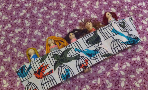 clothespin dolls taking a nap