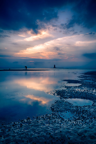 ocean sunset lighthouse reflection beach water clouds de bay sand day glow hole cloudy dusk tide crater delaware lowtide snails hdr highdynamicrange lewes