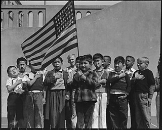 San Francisco, California. Flag of allegiance pledge at Raphael Weill Public School, Geary and Buch . . ., 04/20/1942