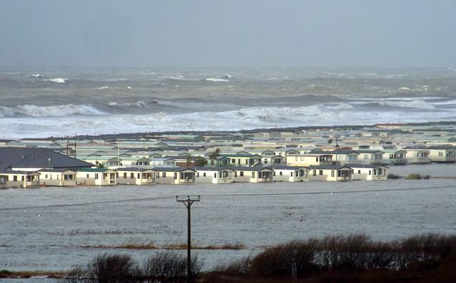 Storm surge floods caravan park.