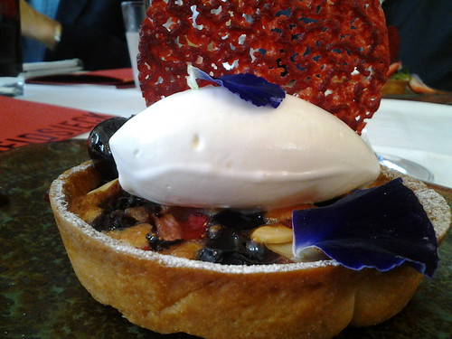 Almond tart with strawberries blueberries and cherries at Lippi Restaurant Brickell