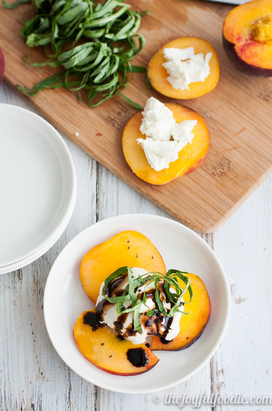 Crisp, sweet peaches pair with fresh basil and mozzarella for a fresh take on a traditional Caprese salad!