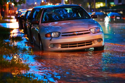 Rising waters often left vehicles stranded or simply inoperable. Photo by Jon Pernul.