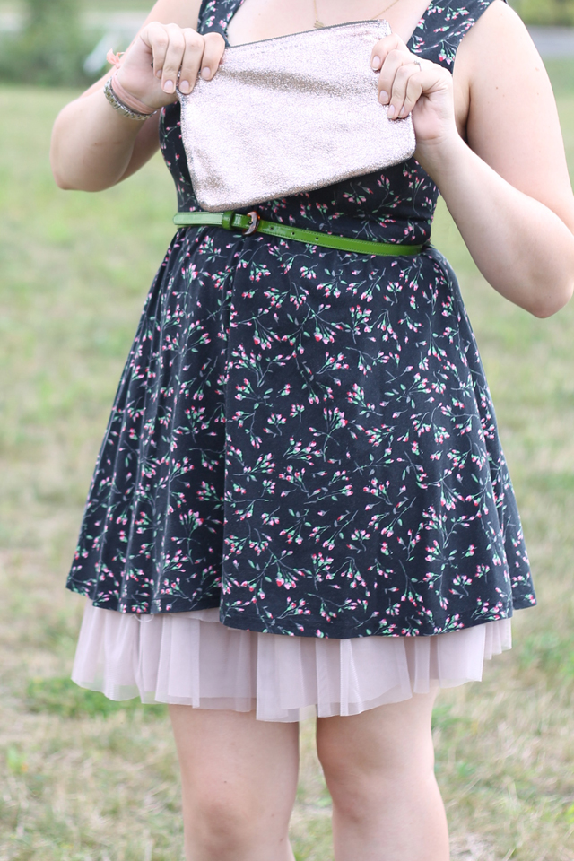 "Petticoat outfit: Black open-back Urban Outfitters dress with pink rosebud print, pink tutu skirt, black ""Everly"" openwork Jeffrey Campbell ankle boots, green leather belt, metallic rose Marc by Marc Jacobs for Target pouch clutch"