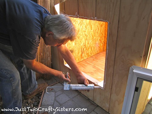 Building a dog house with a window