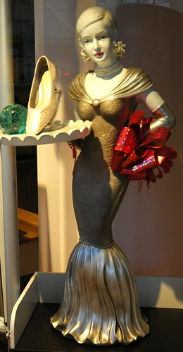 Shoe salesgirl statue, shoe, glass, red bow, San Mateo, California, USA by Wonderlane