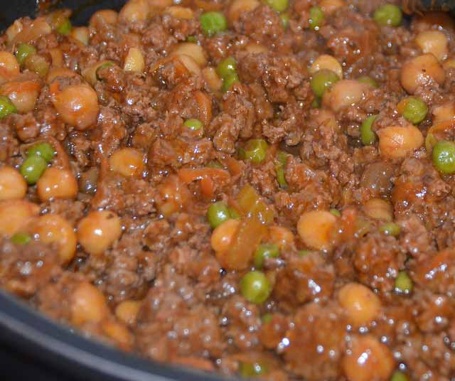 plate of beef mince with peas and vegetables