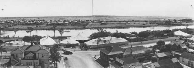 Vaudeville marquees on Quay Street at the edge of the Burnett River in Bundaberg 1935