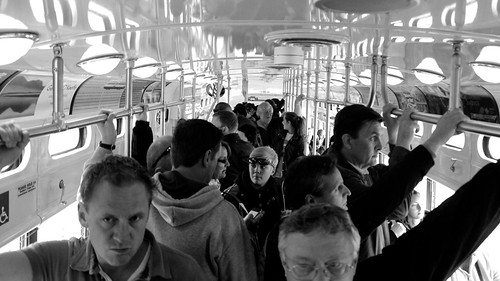 A crowded street car headed down the Embarcadero