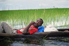 Zambian man on  pirogue, Lealui Island, Barotseland, Zambia