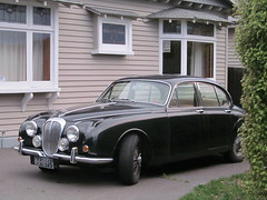 jaguar mark ix(0.0), automobile(1.0), executive car(1.0), daimler 250(1.0), jaguar mark 2(1.0), vehicle(1.0), jaguar mark 1(1.0), mitsuoka viewt(1.0), antique car(1.0), sedan(1.0), classic car(1.0), vintage car(1.0), land vehicle(1.0), luxury vehicle(1.0), jaguar s-type(1.0),