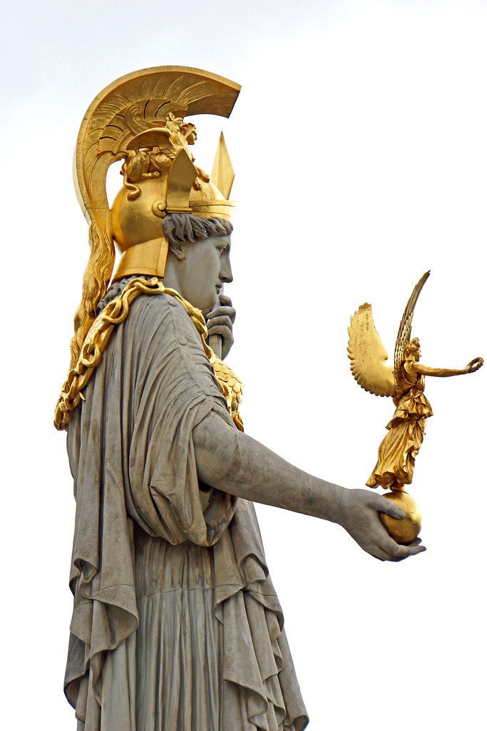 Photograph of large-scale Athena stone statue topped with gold headdress