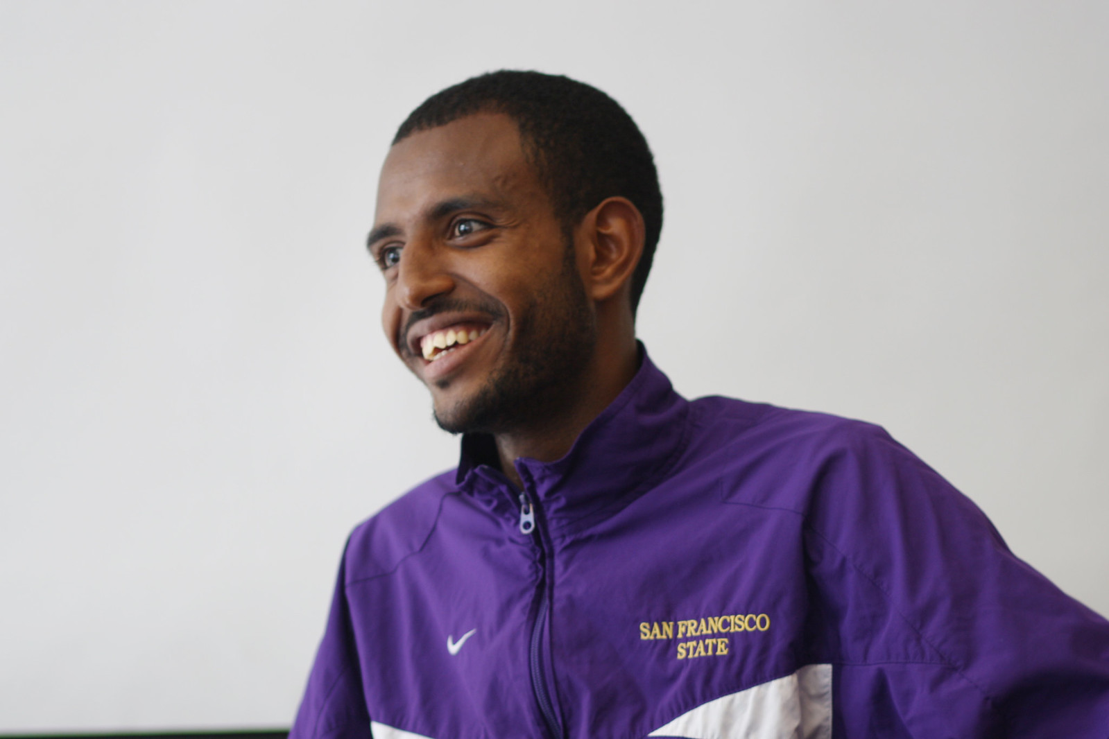 Senior cross country runner Bruk Assefa being interviewed in the gymnasium conference room on August 29, 2013. Photo by Tony Santos / Xpress