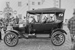 ford model a(0.0), automobile(1.0), wheel(1.0), vehicle(1.0), automotive design(1.0), ford model tt(1.0), monochrome photography(1.0), touring car(1.0), antique car(1.0), classic car(1.0), vintage car(1.0), land vehicle(1.0), monochrome(1.0), black-and-white(1.0), ford model t(1.0),