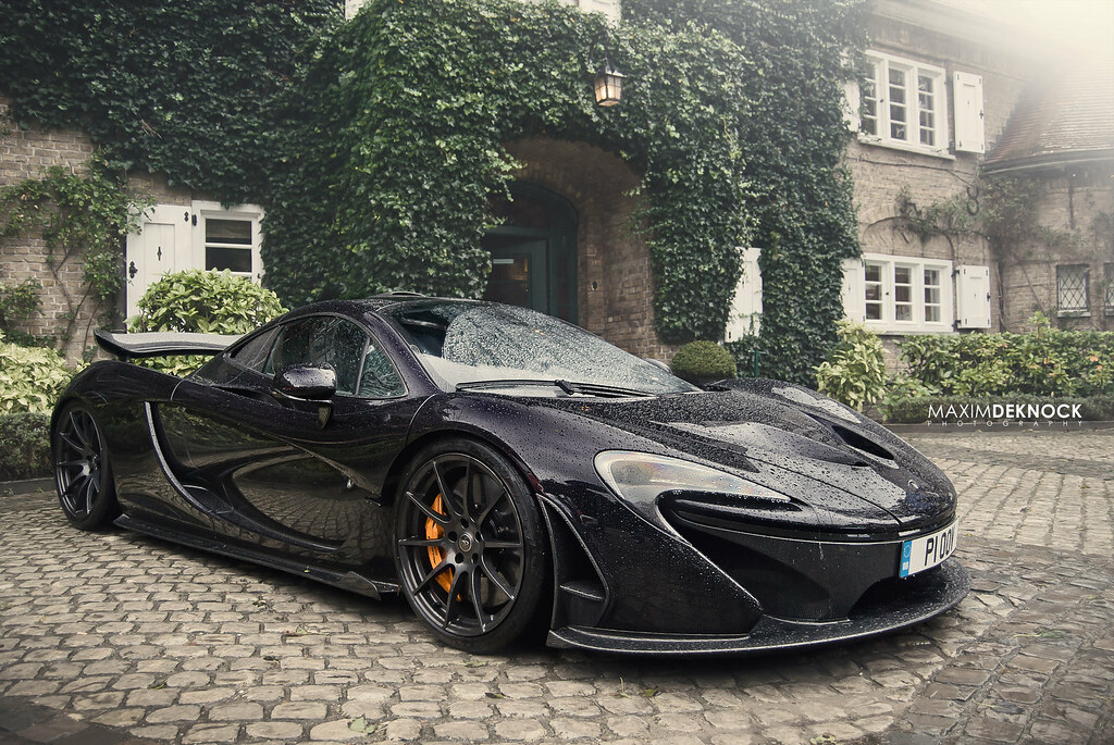 mclaren p1 on a rainy day | photo taken during the concours … | flickr