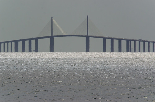 Sun glistening on Sunshine Skyway Bridge