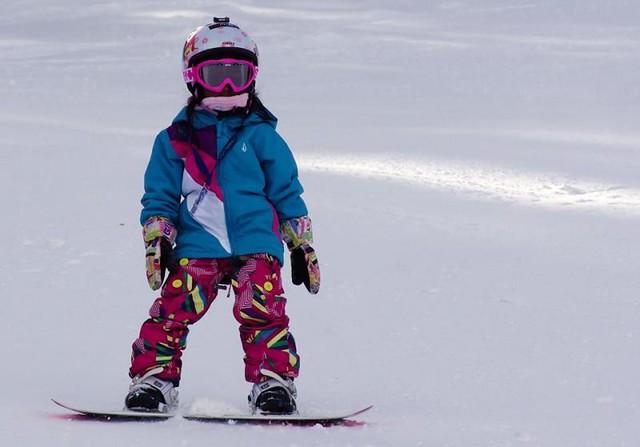 Kid snowboarding at Loveland