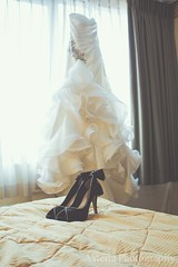 Bride's black shoes and dress
