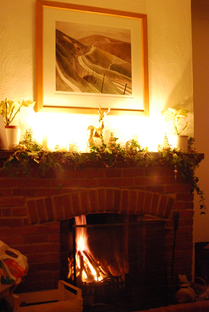 chambray and curls log fire and candles at Christmas