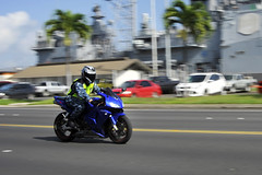 Sailor rides his motorcycle on Joint Base Pearl