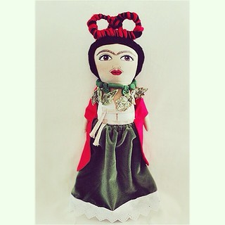 Restoring femininity :: After her divorce from Diego Rivera in 1939, Frida cut off her long hair and rejected her femininity - to express the pain she felt over the separation. This doll is made like the self portrait that was painted shortly after their