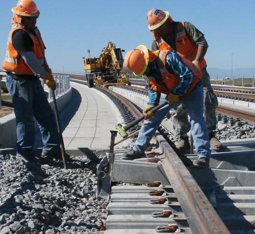 Photo of rail installation on Pena Boulevard Bridge