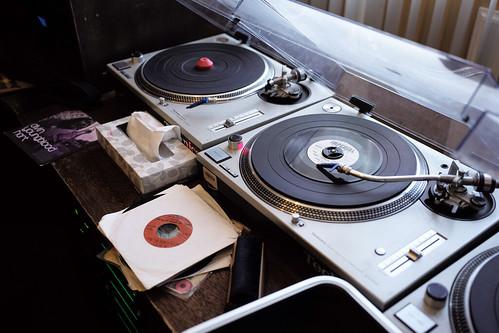 Turntables and vinyl in the studio. Photo by Ken Maldonado.
