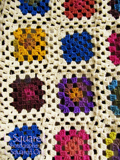 Close-up of colorful granny squares.