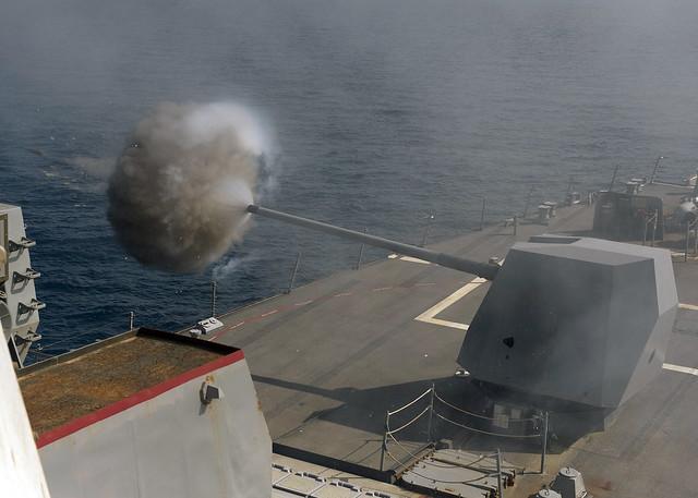 USS Bulkeley fires its 5-inch gun.