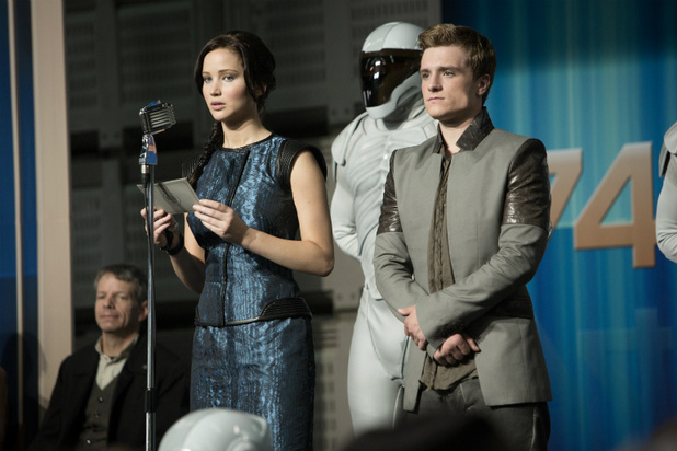 Katniss looks uncomfortable onstage reading from a script
