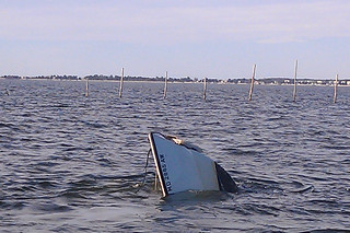 The bow of the 22-foot boat that capsized and sank with two men aboard approximately 200 yards off St. George Island, Md., Friday Dec. 13, 2013. A Coast Guard crew aboard a 25-foot Response Boat Small from Coast Guard Station St. Inigoes Md., diverted to the scene and rescued the two men. U.S. Coast Guard photo by Petty Officer 3rd Class Charles Murray