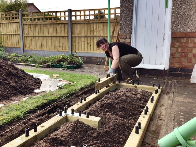 Jen building the raised bed