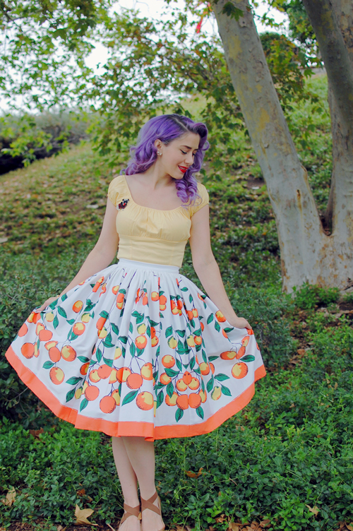 Pinup Girl Clothing Peasant top in yellow Jenny skirt in Orange print