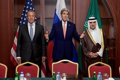 U.S. Secretary of State John Kerry addresses reporters as he stands with Russian Foreign Minister Sergey Lavrov and Saudi Arabia Foreign Minister Adel bin Ahmed al-Jubeir before a trilateral meeting focused on Syria and other issues following a meeting of the Gulf Cooperation Council in Doha, Qatar, on August 3, 2015. [State Department photo/ Public Domain]