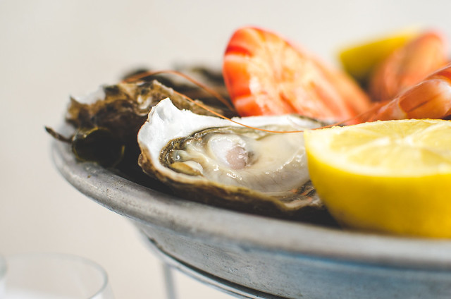 Oysters at Huitrerie Régisare don't need much, but they're served with plenty of lemon and a vinegar mignonette.