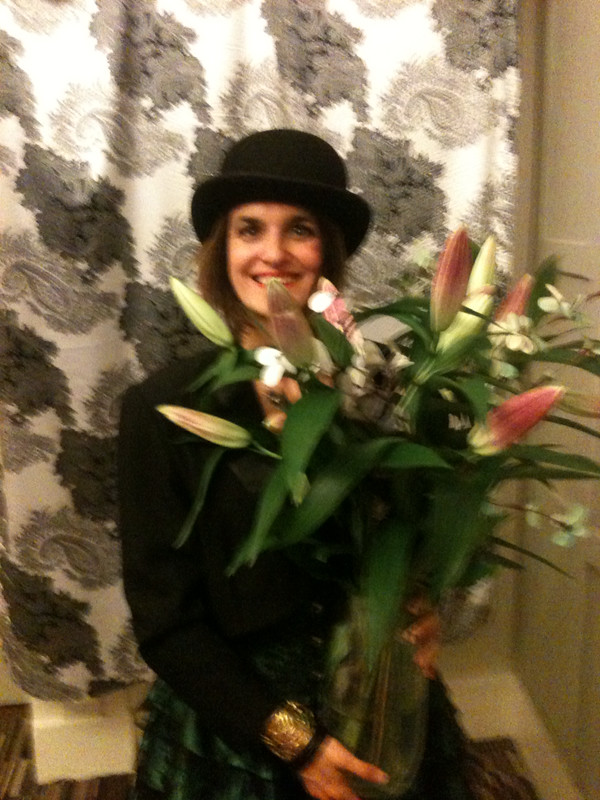 Woman with flowers in a bowler hat