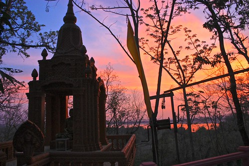 sunset behind a shrine to Buddha