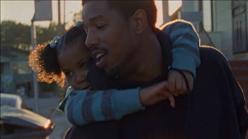 A still from Fruitvale Station of Oscar Grant hugging someone