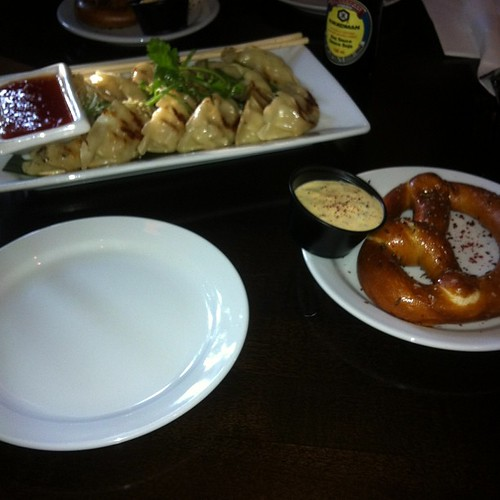 Gyoza and Bavarian pretzel at Brewsters. #yegfood by raise my voice