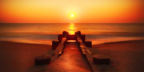 ocean longexposure morning light sky sun reflection beach water sunrise de dawn pier sand waves horizon filter rays delaware rehoboth berm hdr highdynamicrange breakwater fineartphotography neutraldensity