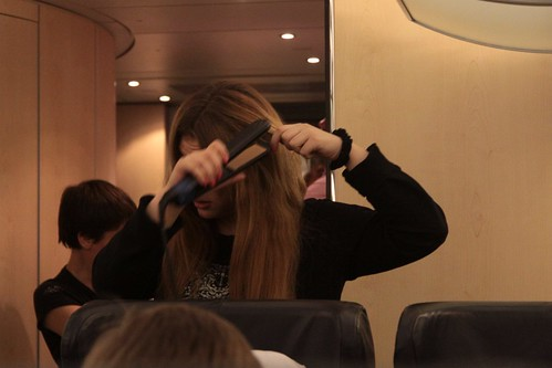 Woman straightening her hair onboard a Russian train