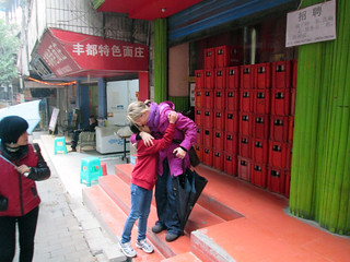Christine Romboletti and her daughter Olivia Rose, at the site in Fuling where Olivia Rose was found abandoned ten years ago.