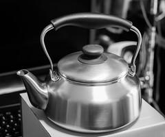 espresso(0.0), wheel(0.0), drink(0.0), small appliance(0.0), stovetop kettle(1.0), monochrome photography(1.0), monochrome(1.0), black-and-white(1.0), teapot(1.0),