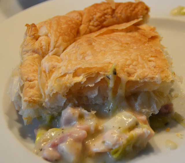 pieces of chicken and leek pie on a plate