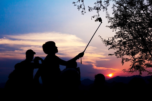 camera travel light sunset sky people orange sun mountain man black male nature silhouette yellow digital sunrise landscape person photography during photo photographer view shot image outdoor background tripod young picture lifestyle tourist hobby photograph taking lao luangprabang luang prabang selfie phusi