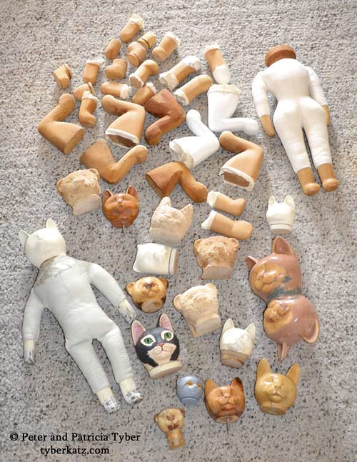 Cat art doll heads, bodies, and legs by Peter and Patricia Tyber of Tyber Katz