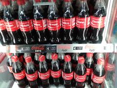 beer bottle(0.0), soft drink(1.0), carbonated soft drinks(1.0), drink(1.0), cola(1.0), coca-cola(1.0), brand(1.0),