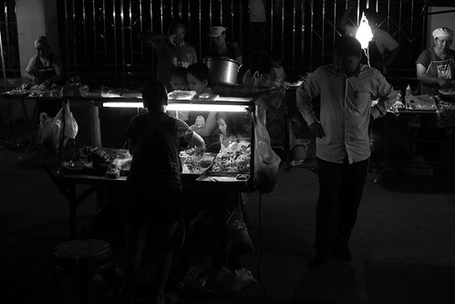 Mother and children buying street food at Ban Anou night market, Vientiane, Laos. 2013 by daveweekes68